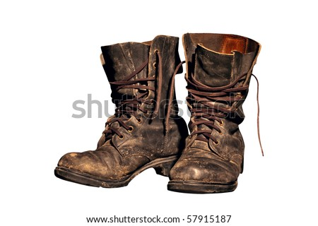 old soldier's boots worn with scratches and untied shoelaces - stock photo