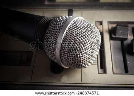 Old sound player with microphone. - stock photo