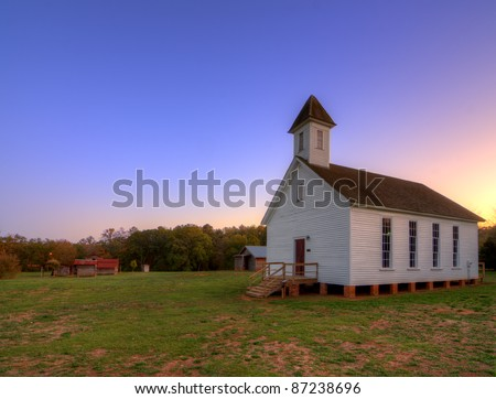 old southern baptist chapel in an historic village - stock photo