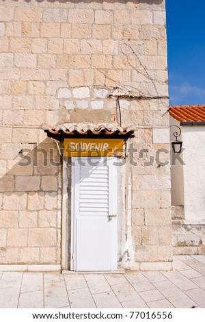 Old souvenir shop doors in the old walls of Dubrovnik, Croatia - stock photo