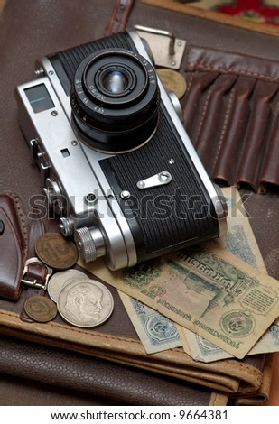 Old soviet film camera and money vertical close up