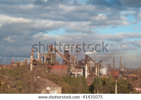 old Soviet metallurgical plant on the background of a beautiful sky - stock photo