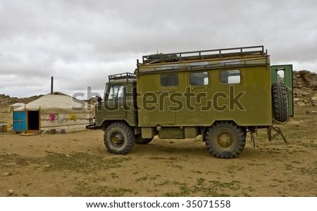 Old Soviet military truck GAZ-66 in Gobi Desert, Mongolia - stock photo