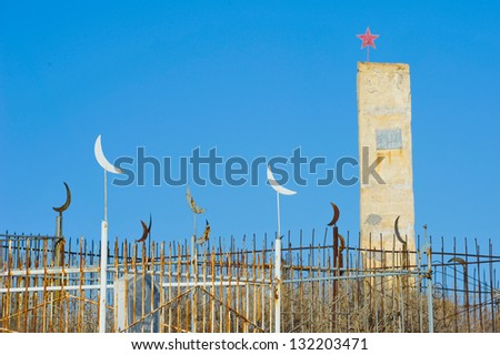 Old soviet monument on islamic cemetery in Kazakhstan - stock photo