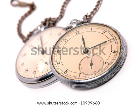 Old soviet pocket watch covered with rust and dust. Focus on first