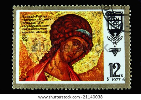 Old Soviet postage stamp with archangel on black background - stock photo