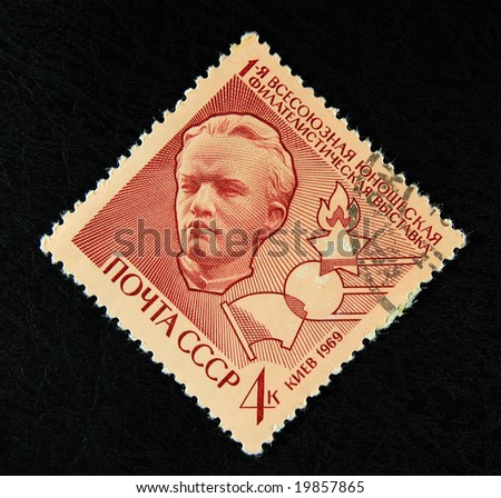 Old Soviet postage stamp with young Lenin - stock photo