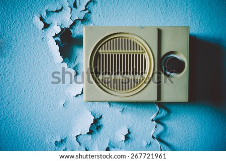 Old Soviet radio on painted walls in an abandoned building. Russian propaganda - stock photo
