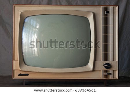 Old soviet retro TV on a gray background. The inscription on the white button On. The inscription on the black button Off