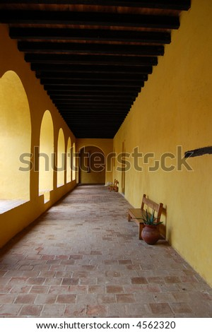 Old spanish convent bench - stock photo