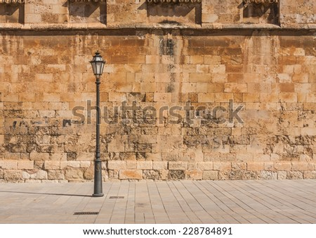 Old spanish wall on the street - stock photo
