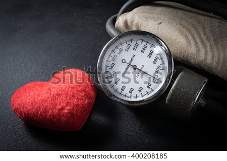 Old Sphygmomanometer with heart shape. - stock photo