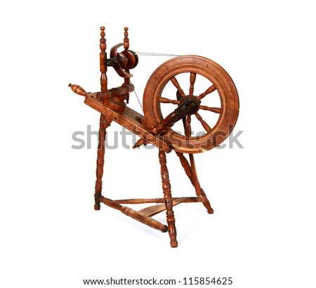 Old spinning wheel isolated on white - stock photo