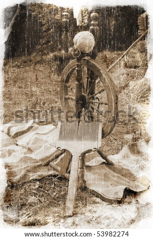 Old spinning-wheel (vintage style, with a grungy effect added) - stock photo