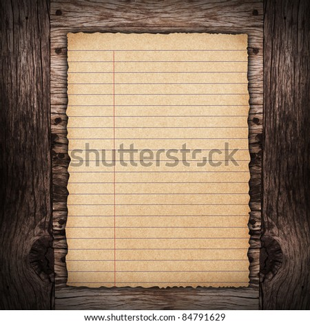 old spiral paper on brown wood texture with natural patterns. Useful as background for design-works. - stock photo