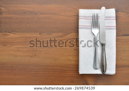 Old spoon on cloth - stock photo