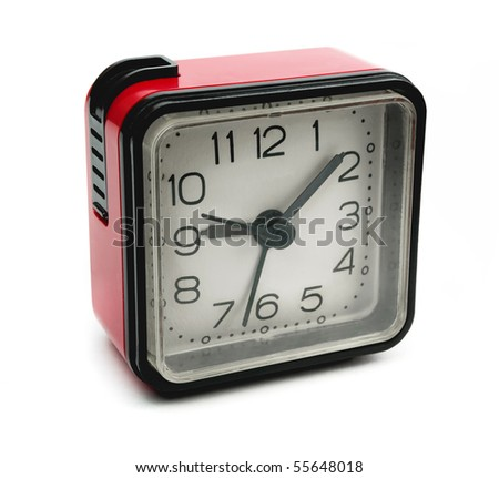 Old square red alarm clock isolated on white