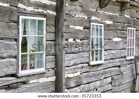 Old stack log house - stock photo
