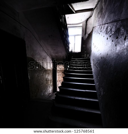 old staircase in dramatic light - stock photo
