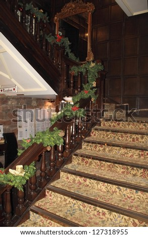 old staircase with carpet and decorated for the christmas season