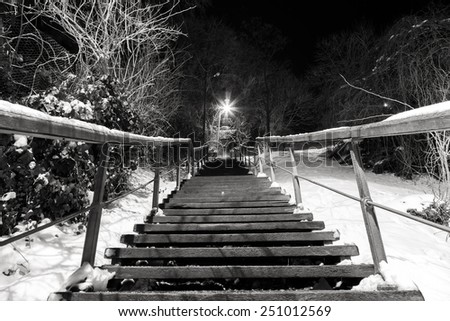 Old stairs in the snow - Night shot, B&W - stock photo