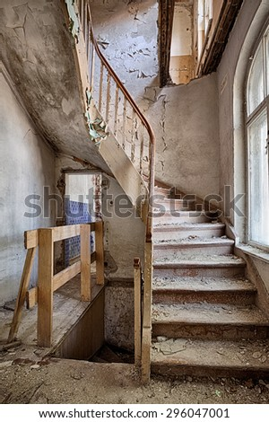 Old stairs inside a forgotten home - stock photo