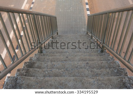 Old stairs of the overpass in the city