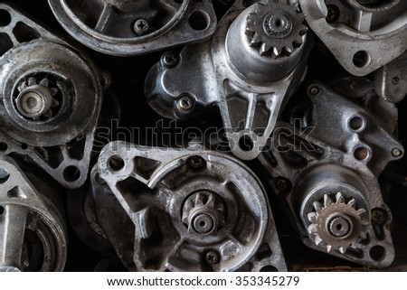 Old starter motor car on shelf - stock photo