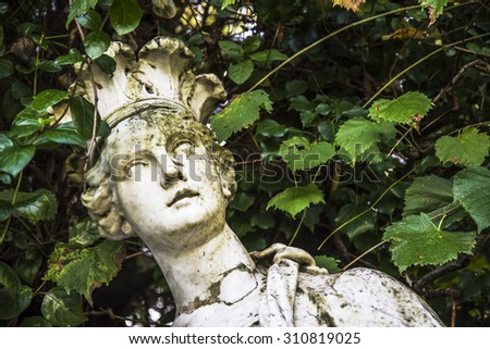 Old statue inside the Royal Palace garden in Caserta, Italy