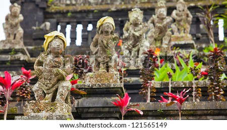 Old statues at the Mother Temple at Besakih in Bali, Indonesia - stock photo