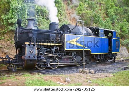 Old steam engine at Nilgiri Mountains Railway, India - stock photo