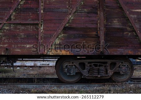 Old steam engine train wheels and parts close-up - stock photo