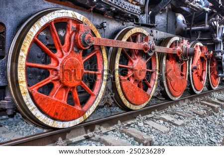 Old steam locomotive engine wheel and rods details - stock photo