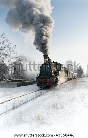 Old steam locomotive in the snow - stock photo