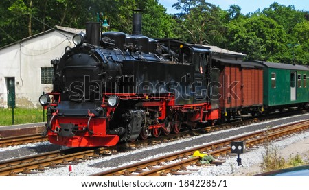 "Old steam locomotive ""Rasender Roland"" at the Islan Ruegen, Germany, Baltic Sea - stock photo"