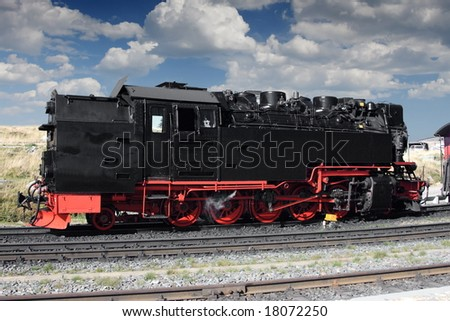 Old steam locomotive rising on mountain Brocken in Germany