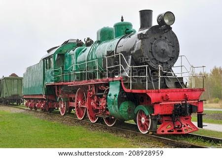 Old steam locomotive under heavy rain. Haapsalu, Estonia - stock photo