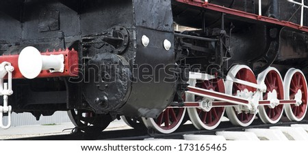 Old steam locomotive wheels close up - stock photo
