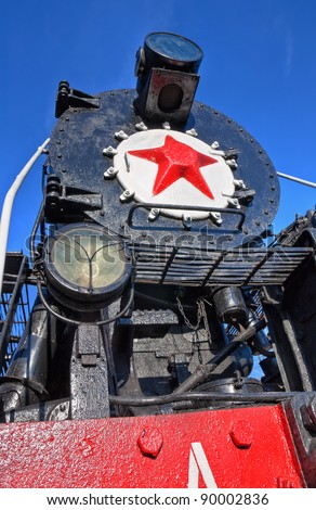 Old steam locomotive with red star - stock photo