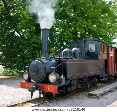 Old steam train - stock photo