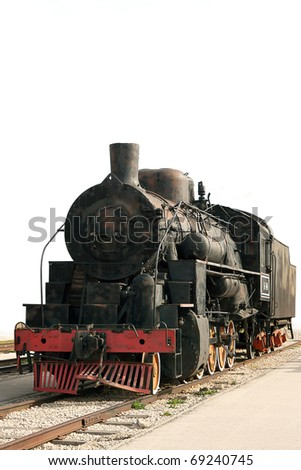 Old steam train isolated on white - stock photo