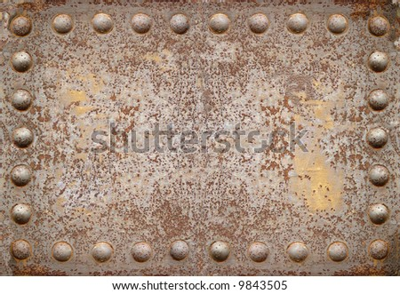 old steel plate with bright rivets - stock photo