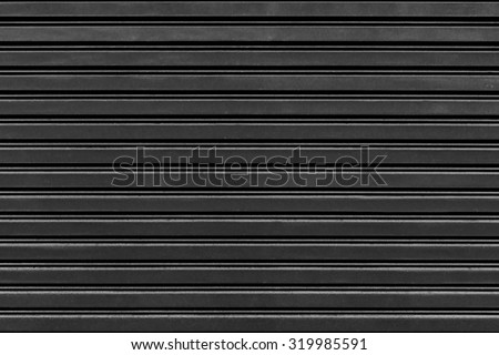 old steel rolling shutter background (black and white tone color) - stock photo