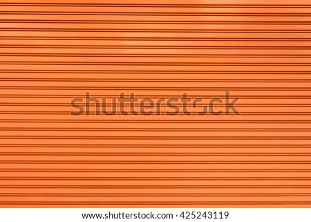 old steel rolling shutter background (orange color) - stock photo