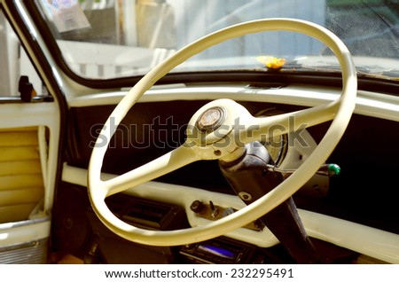 Old steering wheel interior in old vintage automobile/ Old steering wheel/   / Old steering wheel interior in old vintage automobile (steering, vintage, automobile)  - stock photo