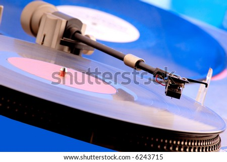 old stereo  player on  background of  vinyl disk - stock photo