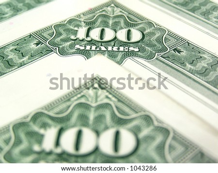 Old stock certificates - common & capital stock. Colorful closeup on the documents. - stock photo