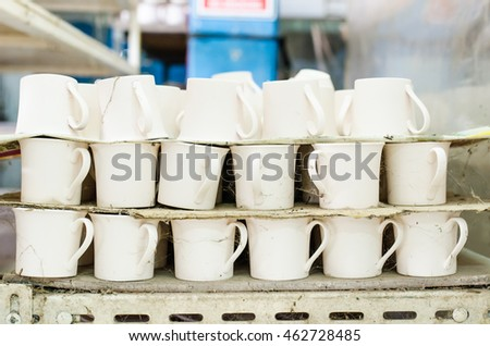 old stock of stacked cup in a factory,Selective focus