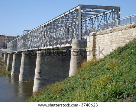 Old stone and steel bridge