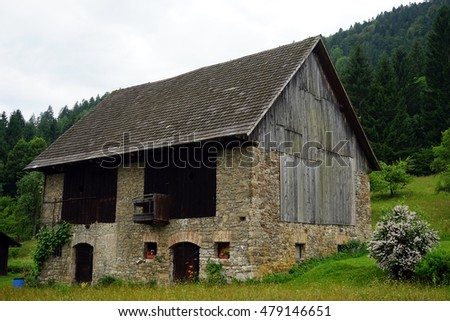 Old stone barn with wooden roof in Austria